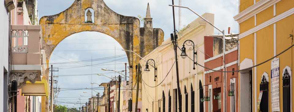On Calle 61, an arched gate along the original city wall marks the entrance to Merida. Walk the street and trace the history.