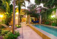 The large pool and tropical garden are a great place for a family on vacation to gather at Casa Encanto, the ideal Merida vacation rental for families
