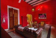 This charming vacation rental in Merda, Mexico features high beamed ceilings traditional pasta tile in its grand front room
